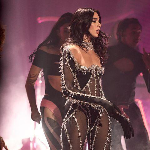 "<p>Taking a leaf out of friend and collaborator <a href=""https://www.elle.com/uk/fashion/a34087013/miley-cyrus-sheer-mugler-bodysuit-photo/"" rel=""nofollow noopener"" target=""_blank"" data-ylk=""slk:Miley Cyrus"" class=""link rapid-noclick-resp"">Miley Cyrus</a>' book, Dua Lipa wore a sheer bodysuit by Mugler for her STUDIO2054 performance. The crystal-embellished catsuit wasn't the only look of the night, however, with the 25 year-old donning multiple epic ensembles for the live streamed gig. </p><p><a class=""link rapid-noclick-resp"" href=""https://go.redirectingat.com?id=127X1599956&url=https%3A%2F%2Fwww.net-a-porter.com%2Fen-gb%2Fshop%2Fdesigner%2Fmugler&sref=https%3A%2F%2Fwww.elle.com%2Fuk%2Ffashion%2Fcelebrity-style%2Fg19613955%2Fdua-lipas-style-file%2F"" rel=""nofollow noopener"" target=""_blank"" data-ylk=""slk:SHOP MUGLER NOW"">SHOP MUGLER NOW </a></p><p><a href=""https://www.instagram.com/p/CIHVRrdsEcA/"" rel=""nofollow noopener"" target=""_blank"" data-ylk=""slk:See the original post on Instagram"" class=""link rapid-noclick-resp"">See the original post on Instagram</a></p>"