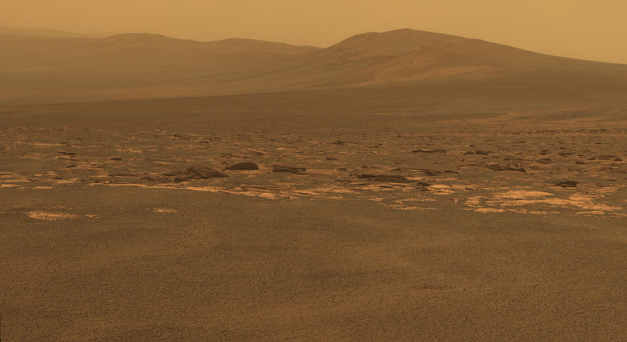 "A portion of the west rim of Endeavour crater sweeps southward in this color view from NASA's Mars Exploration Rover Opportunity released by NASA August 10, 2011. This crater has a diameter of about 14 miles (22 km). This view combines exposures taken by Opportunity's panoramic camera (Pancam) of the rover's work on Mars August 6, 2011. Opportunity arrived at the rim during its next drive on August 9, 2011. Endeavour crater has been the rover team's destination for Opportunity since the rover finished exploring Victoria crater in August 2008. Endeavour offers access to older geological deposits than any Opportunity has seen before. The lighter-toned rocks closer to the rover in this view are similar to the rocks Opportunity has driven over for most of the mission. However, the darker-toned and rougher rocks just beyond that might be a different type for Opportunity to investigate. The ground in the foreground is covered with iron-rich spherules, nicknamed ""blueberries,"" which Opportunity has observed frequently since the first days after landing. They are about 0.2 inch (5 millimeters) or more in diameter. REUTERS/NASA/JPL-Caltech/Cornell/ASU/Handout   (UNITED STATES - Tags: SCI TECH) FOR EDITORIAL USE ONLY. NOT FOR SALE FOR MARKETING OR ADVERTISING CAMPAIGNS. THIS IMAGE HAS BEEN SUPPLIED BY A THIRD PARTY. IT IS DISTRIBUTED, EXACTLY AS RECEIVED BY REUTERS, AS A SERVICE TO CLIENTS"