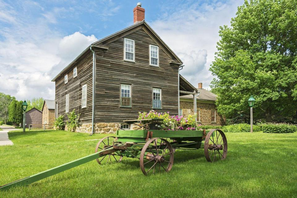 """<p>The <a href=""""http://www.amanacolonies.com"""" rel=""""nofollow noopener"""" target=""""_blank"""" data-ylk=""""slk:historic Amana Colonies"""" class=""""link rapid-noclick-resp"""">historic Amana Colonies</a> are made up of a total of seven villages. Settled by German Pietists who lived a communal lifestyle until the 1930s, the colonies are approximately 150 years old. Today, they attract visitors with charming brick and clapboard homes, blooming gardens, and locally made beer and wine.</p><p><em><a href=""""http://www.housebeautiful.com/lifestyle/g3345/historic-homes/"""" rel=""""nofollow noopener"""" target=""""_blank"""" data-ylk=""""slk:See more of the most historic houses in America."""" class=""""link rapid-noclick-resp"""">See more of the most historic houses in America.</a></em><br></p>"""