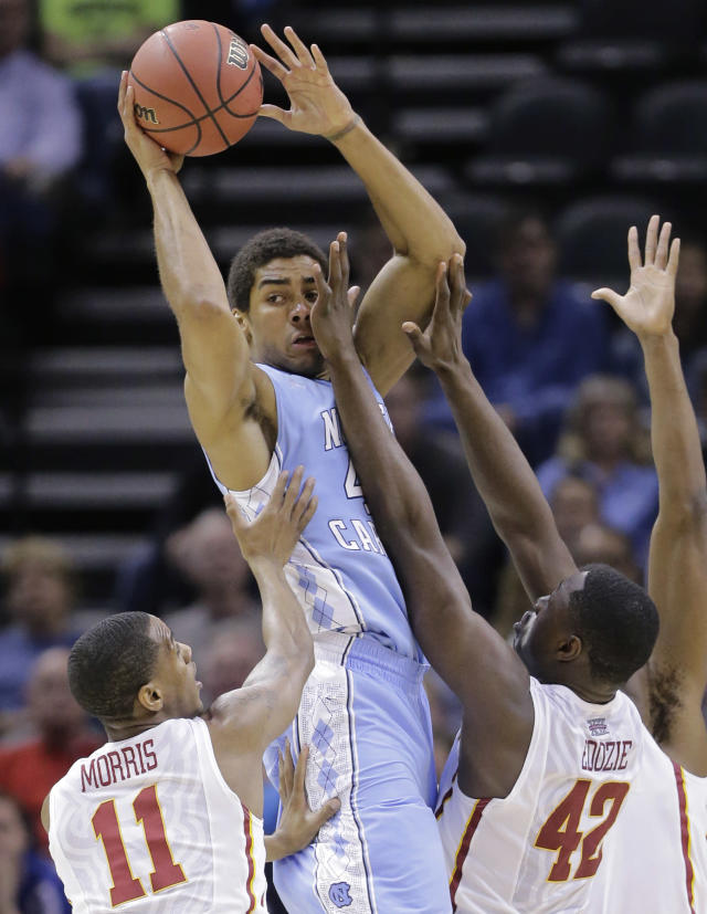 North Carolina's James Michael McAdoo, center, is pressured by Iowa State's Monte Morris (11) and Daniel Edozie (42) during the first half of a third-round game in the NCAA college basketball tournament Sunday, March 23, 2014, in San Antonio. (AP Photo/Eric Gay)
