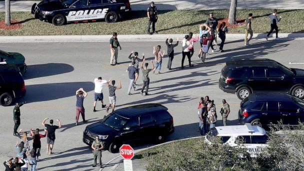 PHOTO: Students hold their hands in the air as they are evacuated by police from Marjory Stoneman Douglas High School in Parkland, Fla., after a shooter opened fire on the campus, Feb 14, 2018. (Mike Stocker/South Florida Sun-Sentinel via AP, FILE)
