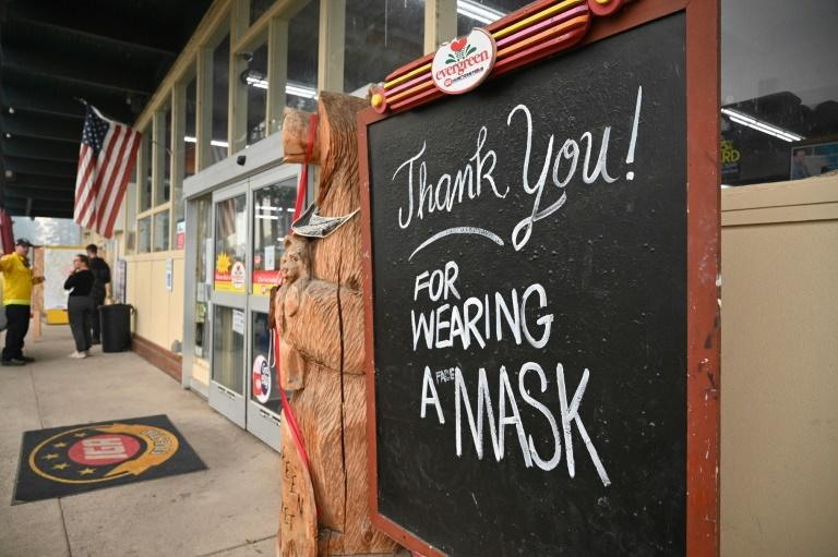 """A sign reads """"Thank you! For Wearing A Mask,"""" outside a supermarket in Indian Valley, California"""