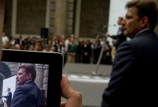 Mexican presidential candidate for the Institutional Revolutionary Party (PRI), Enrique Pena Nieto is seen on an iPad