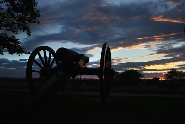 GETTYSBURG, PA - JUNE 28: A canon aims from the Gettysburg National Military Park ahead of the 150th anniversary of the Battle of Gettysburg on June 28, 2013 in Gettysburg, Pennsylvania. Some 8,000 re-enactors are participating events marking the July 1-3, 1863 Battle of Gettysburg, considered the turning point in favor of the Union in the American Civil War. Union and Confederate armies suffered a total of 46,000-51,000 casualties in the battle, the largest number in the war. (Photo by John Moore/Getty Images)