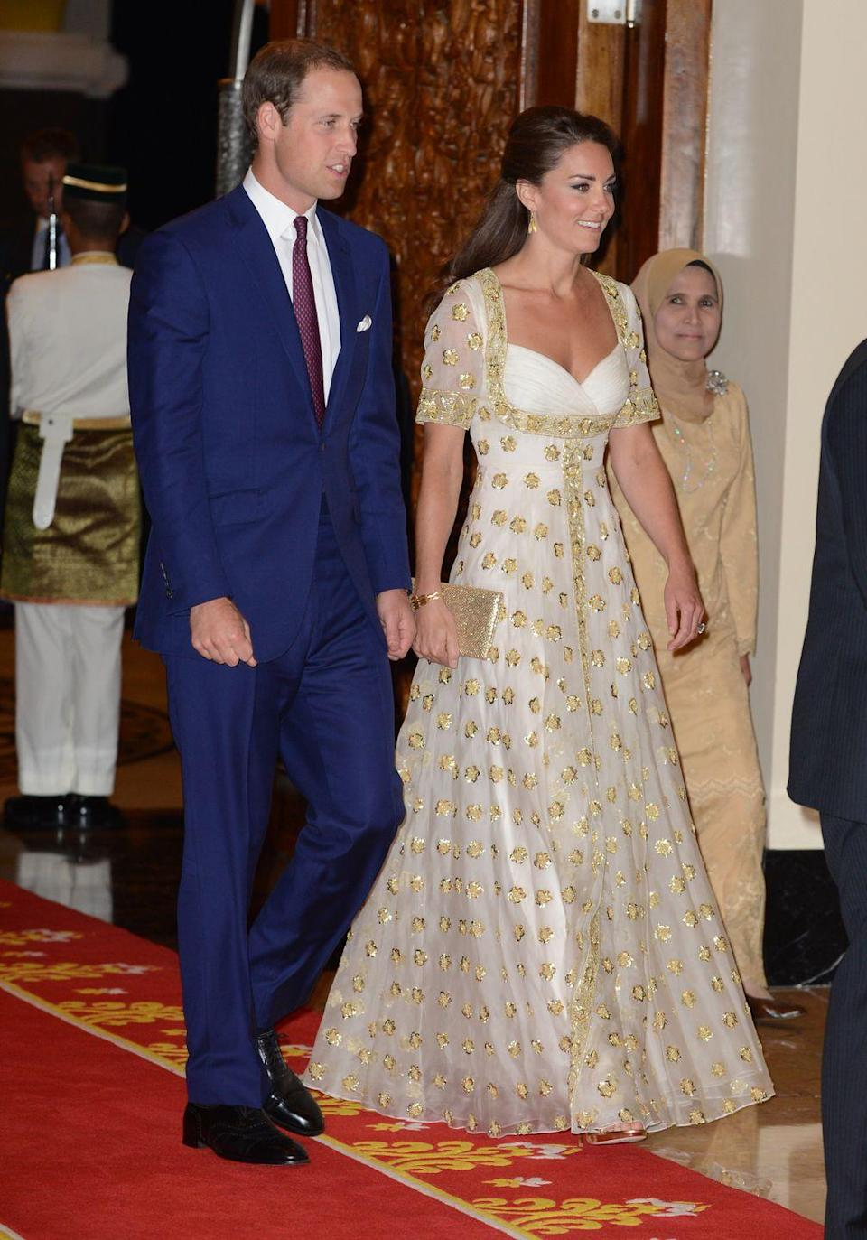 <p>The Duke and Duchess of Cambridge visited Kuala Lumpur, Malaysia as part of the Diamond Jubilee Tour in 2012. Kate wore custom, gilded McQueen to an official dinner hosted by Malaysia's Head of State.</p>
