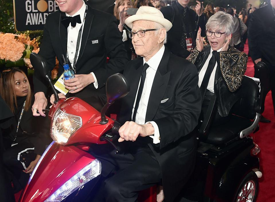 """<p>Still rolling at the age of 95 in 2018, <a href=""""https://people.com/tv/golden-globes-2018-norman-lear-rita-moreno-red-carpet-scooter/"""" rel=""""nofollow noopener"""" target=""""_blank"""" data-ylk=""""slk:Lear arrived on the Golden Globe Awards red carpet"""" class=""""link rapid-noclick-resp"""">Lear arrived on the Golden Globe Awards red carpet</a> with Moreno by moped. </p>"""