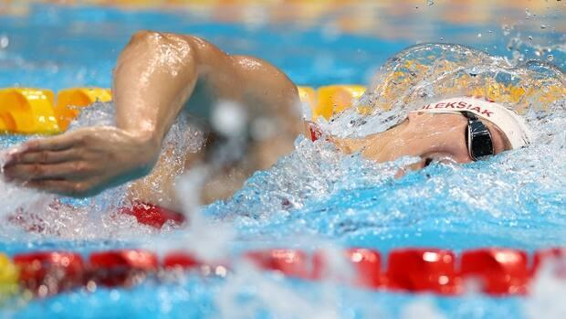 Canada's Penny Oleksiak, pictured, finished 10-100ths of a second shy of reigning Olympic champion Katie Ledecky's top time of 1:55.28 in qualifying for the 200-metre freestyle semifinals on Monday at Tokyo Aquatics Centre. (Kai Pfaffenbach/Reuters - image credit)