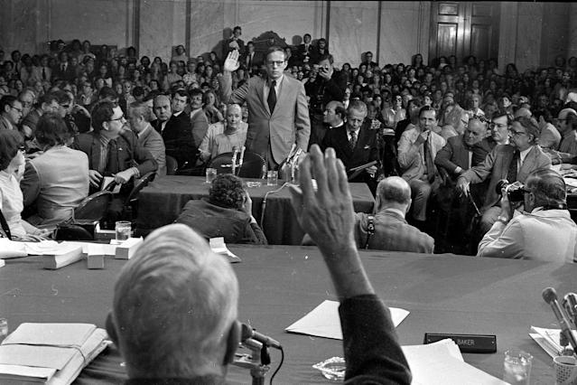 <p>Former White House aide John Dean III is sworn in by Senate Watergate Committee Chairman Sam Ervin, D-N.C. on June 25, 1973. (Photo: AP) </p>