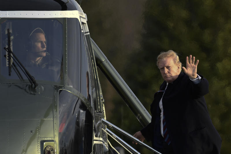 President Donald Trump waves as he walks up the steps of Marine One at Walter Reed National Military Medical Center in Bethesda, Md., Friday, Feb. 8, 2019, after having his annual physical. Trump was in for some poking and prodding as doctors assess his health during his second annual medical checkup as president. (AP Photo/Susan Walsh)