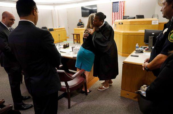 PHOTO: Former Dallas Police Officer Amber Guyger gives State District Judge Tammy Kemp a hug after the judge had given her a Bible and before Guyger left for jail, Oct. 2, 2019, in Dallas. (Tom Fox/AP)