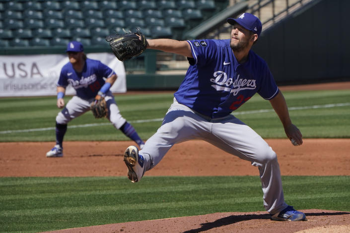 Los Angeles Dodgers' Clayton Kershaw (22) pitches in the first inning of a spring training baseball game against the Kansas City Royals, Friday, March 5, 2021, in Surprise, Ariz. (AP Photo/Sue Ogrocki)