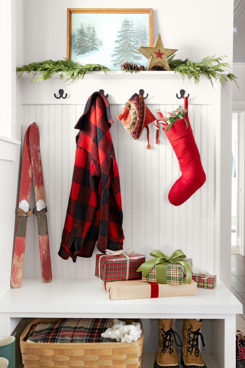 """<p>Custom is great, but even a plain felt stocking hits a festive note in the entryway of this <a href=""""https://www.countryliving.com/home-design/decorating-ideas/g1570/serena-thompson-christmas-decorating-ideas/"""" rel=""""nofollow noopener"""" target=""""_blank"""" data-ylk=""""slk:Washington home"""" class=""""link rapid-noclick-resp"""">Washington home</a>. </p><p><a class=""""link rapid-noclick-resp"""" href=""""https://www.amazon.com/s/ref=nb_sb_noss_2?url=search-alias%3Daps&field-keywords=red+felt+stocking&rh=i%3Aaps%2Ck%3Ared+felt+stocking&tag=syn-yahoo-20&ascsubtag=%5Bartid%7C10050.g.1407%5Bsrc%7Cyahoo-us"""" rel=""""nofollow noopener"""" target=""""_blank"""" data-ylk=""""slk:SHOP FELT STOCKINGS"""">SHOP FELT STOCKINGS</a></p>"""