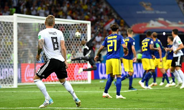 Toni Kroos watches as his stunning free-kick beats the despairing dive of Sweden's goalkeeper, Robin Olsen, to seal Germany's victory with almost the last kick of the game.