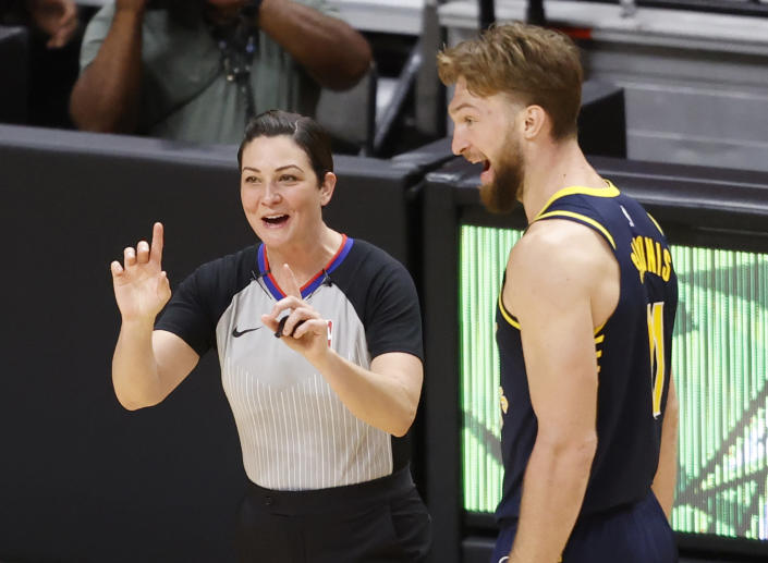Indiana Pacers forward Domantas Sabonis (11) reacts to a foul called by Referee Lauren Holtkamp-Sterling (7) during the second half of an NBA basketball game against the Miami Heat, Sunday, March. 21, 2021, in Miami. (AP Photo/Joel Auerbach)