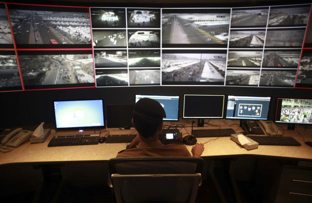 <p>Saudi security officers monitor live feed screens showing Muslim pilgrims in the holy city of Mecca, along with highways and high density areas, during hajj annual pilgrimage, in the holy city of Mecca, in Saudi Arabia. Saturday, Sept. 2, 2017. (Photo: Khalil Hamra/AP) </p>