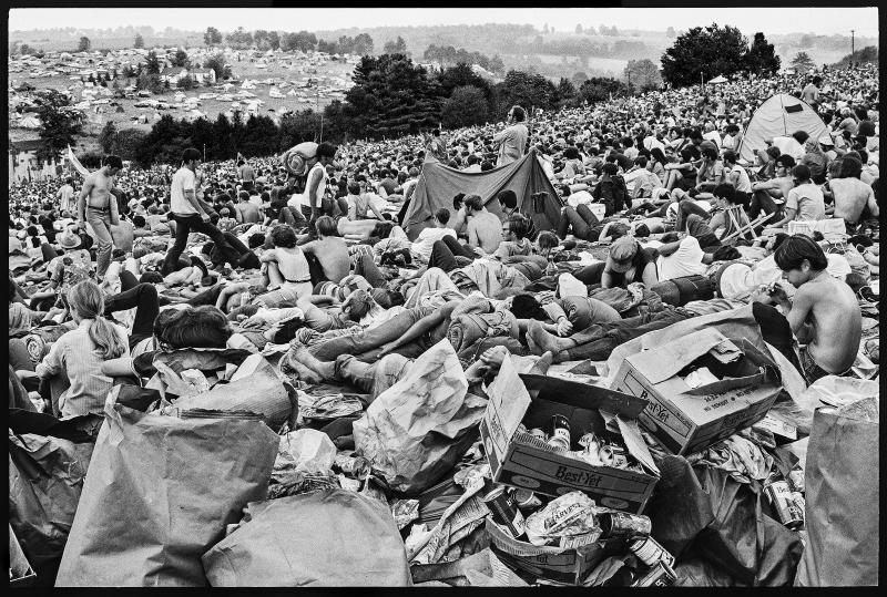 A crowd on the hillside at Woodstock. | Burk Uzzle
