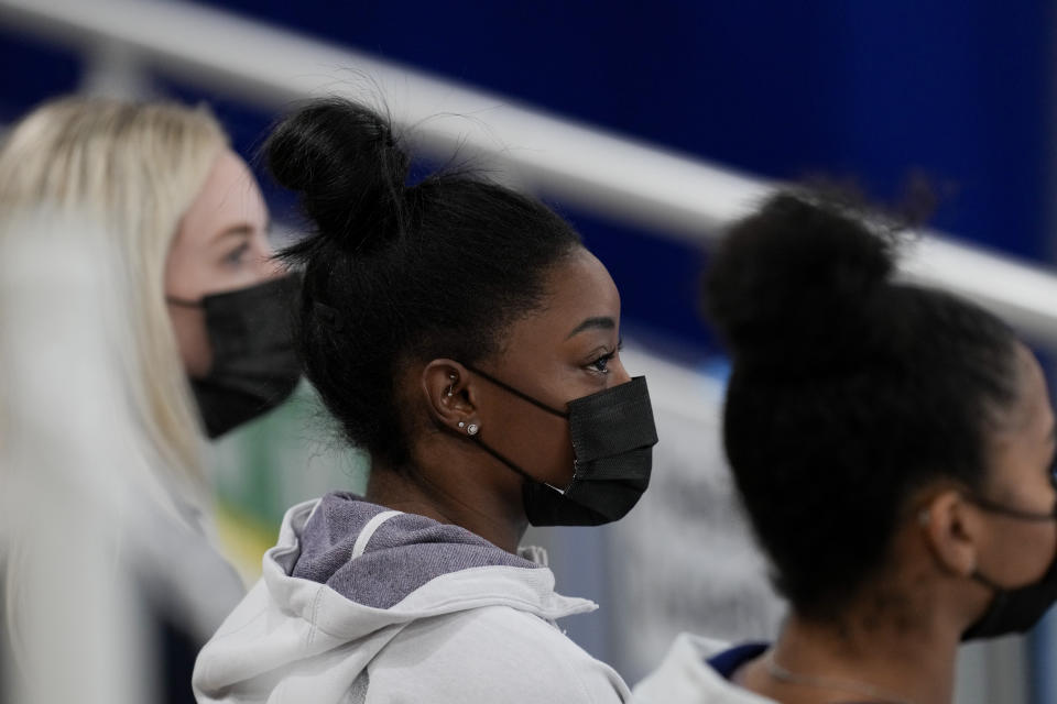 United States gymnast Simone Biles sits on the stands during the artistic gymnastics women's all-around final at the 2020 Summer Olympics, Thursday, July 29, 2021, in Tokyo, Japan. (AP Photo/Natacha Pisarenko)