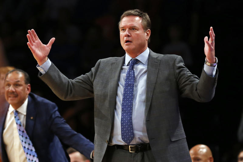 FILE - In this Nov. 23, 2018, file photo, Kansas head coach Bill Self reacts against Tennessee during the second half of an NCAA college basketball game in the NIT Season Tip-Off tournament in New York. There has been more attention on Kansas basketball over the past six months in court rooms than on basketball courts, and Self and the rest of the No. 3 Jayhawks are ready for that to change. (AP Photo/Adam Hunger, File)