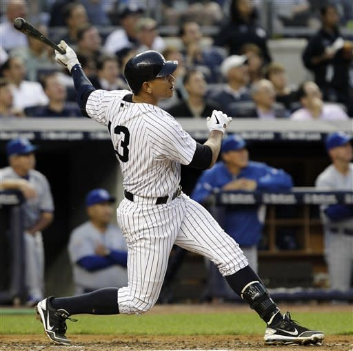 New York Yankees' Alex Rodriguez (13) follows through on his third-inning, solo home run during their baseball game against the Kansas City Royals at Yankee Stadium in New York, Wednesday, May 23, 2012. (AP Photo/Kathy Willens)