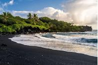 """<p>This beach is named Waianapanapa, Hawaiian for """"<a href=""""https://travel.usnews.com/Maui_HI/Things_To_Do/Waianapanapa_State_Park_61206/"""" rel=""""nofollow noopener"""" target=""""_blank"""" data-ylk=""""slk:glistening water"""" class=""""link rapid-noclick-resp"""">glistening water</a>,"""" because of what rolls into the shore in winsome waves, but what makes this lovely Maui location so striking is its black sand—which is a product of the island's volcanic genesis. Located in <a href=""""https://dlnr.hawaii.gov/dsp/parks/maui/waianapanapa-state-park/"""" rel=""""nofollow noopener"""" target=""""_blank"""" data-ylk=""""slk:Waianapanapa State Park"""" class=""""link rapid-noclick-resp"""">Waianapanapa State Park</a>, this beach also features natural stone arches, caves, and crustacean-filled tidal pools.</p>"""