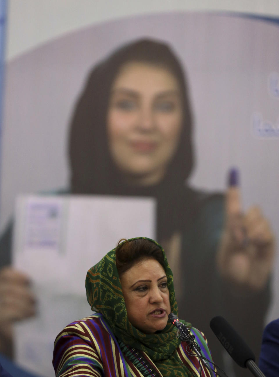 Hawa Alam Nuristani, chief of Election Commission of Afghanistan, speaks during a press conference at the Independent Election Commission office in Kabul, Afghanistan, Tuesday, Feb. 18, 2020. Afghanistan's independent election commission says President Ashraf Ghani has won a second term as president. The commission announced Tuesday that Ghani garnered 50.64% of the vote that took place on Sept. 28 last year to challenger and chief executive Abdullah Abdullah's 39.52%. (AP Photo/Rahmat Gul)