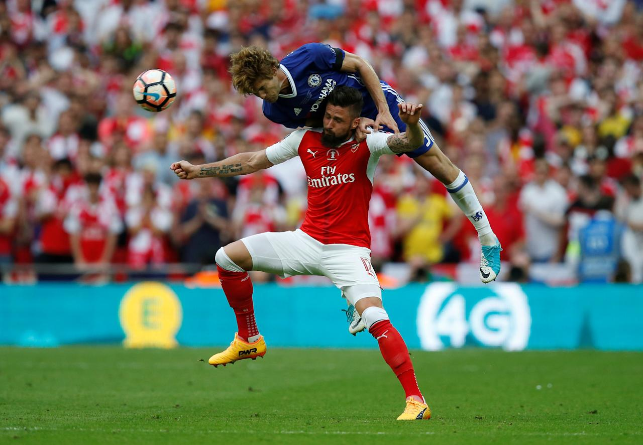"""Britain Soccer Football - Arsenal v Chelsea - FA Cup Final - Wembley Stadium - 27/5/17 Arsenal's Olivier Giroud in action with Chelsea's Marcos Alonso Reuters / Andrew Yates EDITORIAL USE ONLY. No use with unauthorized audio, video, data, fixture lists, club/league logos or """"live"""" services. Online in-match use limited to 45 images, no video emulation. No use in betting, games or single club/league/player publications.  Please contact your account representative for further details."""