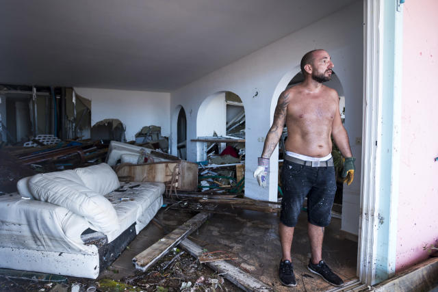 <p>A man reacts as stands in his destroyed home in Orient Bay on the French Carribean island of St. Martin, after the passage of Hurricane Irma, Sept. 7, 2017. (Photo: Lionel Chamoiseau/AFP/Getty Images) </p>