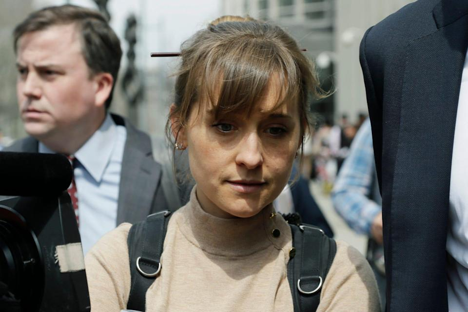 Actress Allison Mack leaves Brooklyn federal court Monday, April 8, 2019, in New York. Mack pleaded guilty to racketeering charges on Monday in a case involving a cult like group based in upstate New York.
