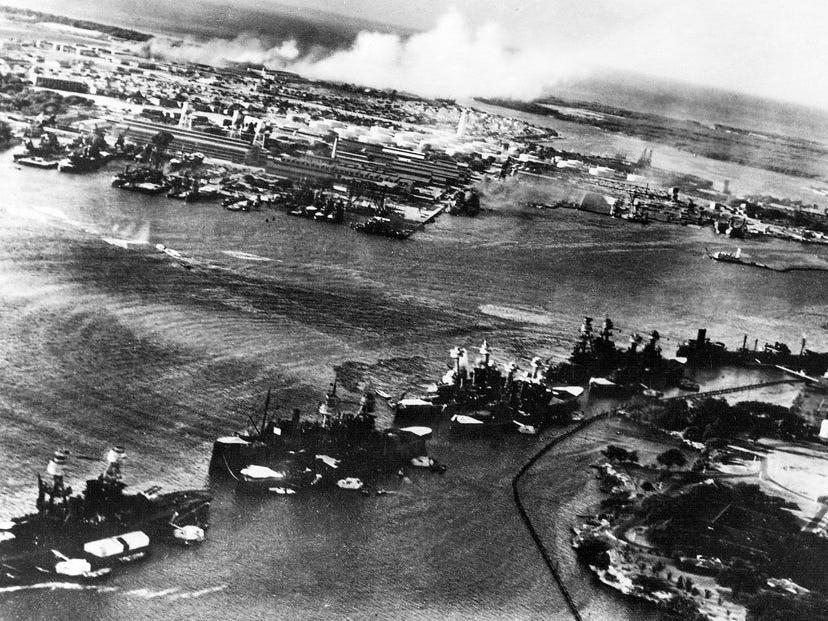 An aerial view of Battleship Row in the opening moments of the raid.