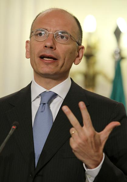 "Italian Prime Minister Enrico Letta makes a statements with Greek Prime Minister Antonis Samaras, not seen, at the Maximos Mansion in Athens, Monday, July 29, 2013. Letta, who is visiting Athens, described the deadly coach crash which occured in Avellino on Sunday night and left at least 37 dead as a ""dramatic moment"" for his entire country: ""The tragedy, the victims and their families, and dramatic situation of the rescue - it's a moment that has deeply touched our nation,"" Letta said after talks with Samaras. (AP Photo/Thanassis Stavrakis)"