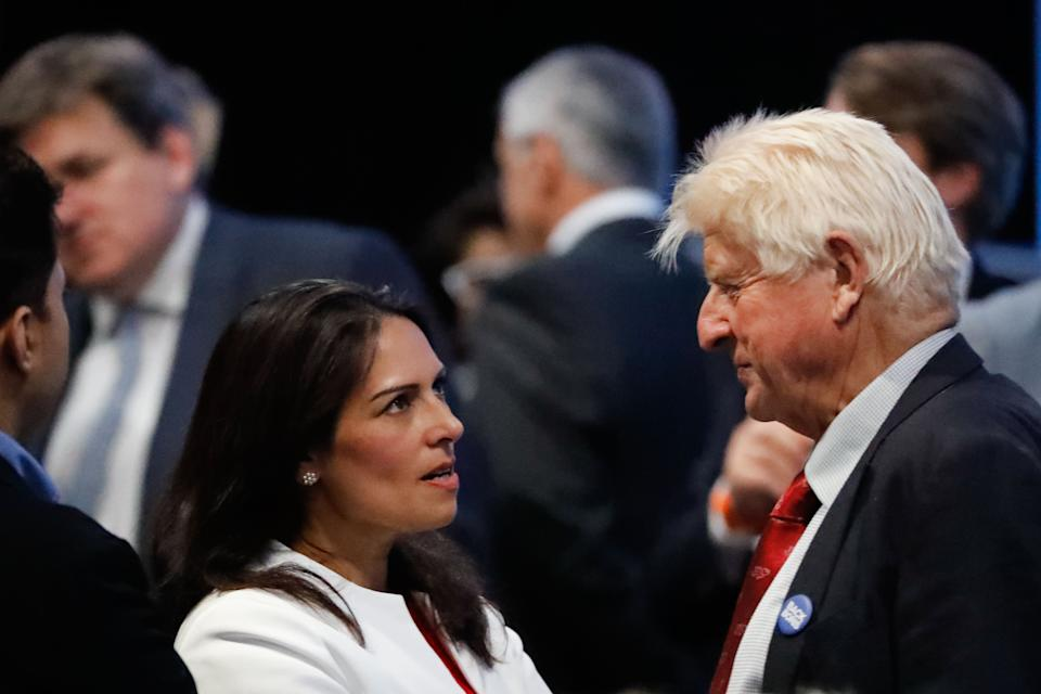 Conservative MP Priti Patel (L) talks with Stanley Johnson (R), father of Conservative MP Boris Johnson, at an event to announce the winner of the Conservative Party leadership contest in central London on July 23, 2019. (Photo by Tolga AKMEN / AFP) (Photo credit should read TOLGA AKMEN/AFP via Getty Images)
