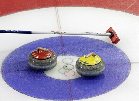 FILE PHOTO: Stones are seen on a sheet during the men's curling round robin games in the Ice Cube Curling Centre at the Sochi 2014 Winter Olympic Games February 16, 2014. REUTERS/Ints Kalnins/File photo