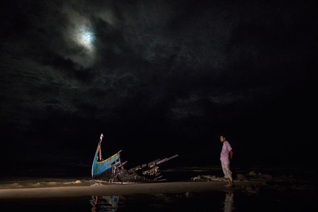 <p>A destroyed boat is seen on a beach washed up after it sunk in rough seas off the coast of Bangladesh carrying over 100 people on September 28 close to Patuwartek, Inani beach, Bangladesh. (Photograph by Paula Bronstein/Getty Images) </p>