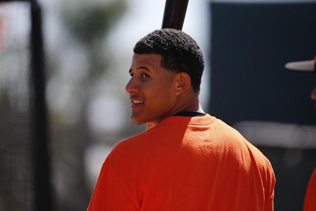 Baltimore Orioles' Manny Machado waits his turn in the batting cage during batting practice before an exhibition spring training baseball game against the Boston Red Sox in Sarasota, Fla.,Saturday, March 8, 2014. (AP Photo/Gene J. Puskar)