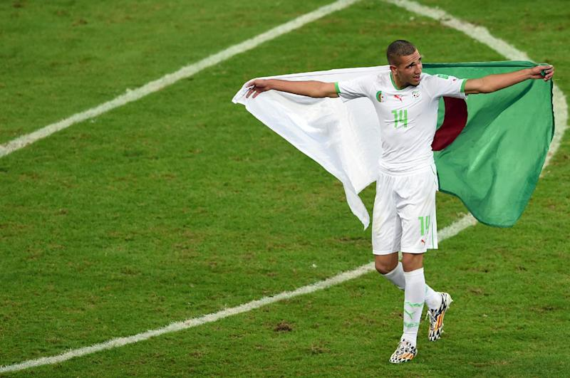 Algeria's midfielder Nabil Bentaleb celebrates his team's victory after a Group H football match at The Baixada Arena in Curitiba on June 26, 2014