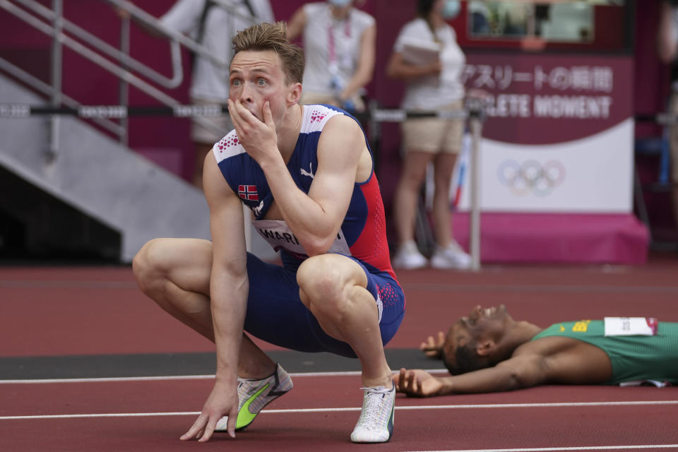 Karsten Warholm, of Norway, celebrates after winning the gold medal in the men's 400-meter hurdles at the 2020 Summer Olympics, Tuesday, Aug. 3, 2021, in Tokyo. (AP Photo/Matthias Schrader)