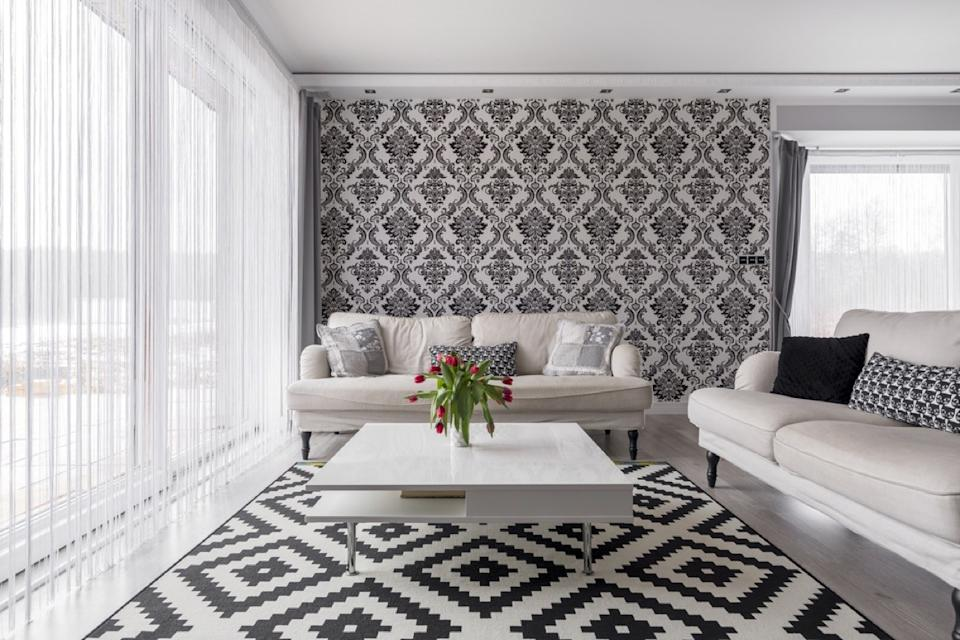 black and white living room with clashing patterns and two white couches