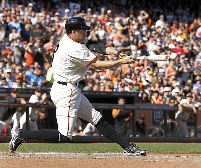 San Francisco Giants' Hunter Pence hits a two-run single against the San Diego Padres during the seventh inning of a baseball game in San Francisco, Sunday, Sept. 29, 2013. (AP Photo/Tony Avelar)