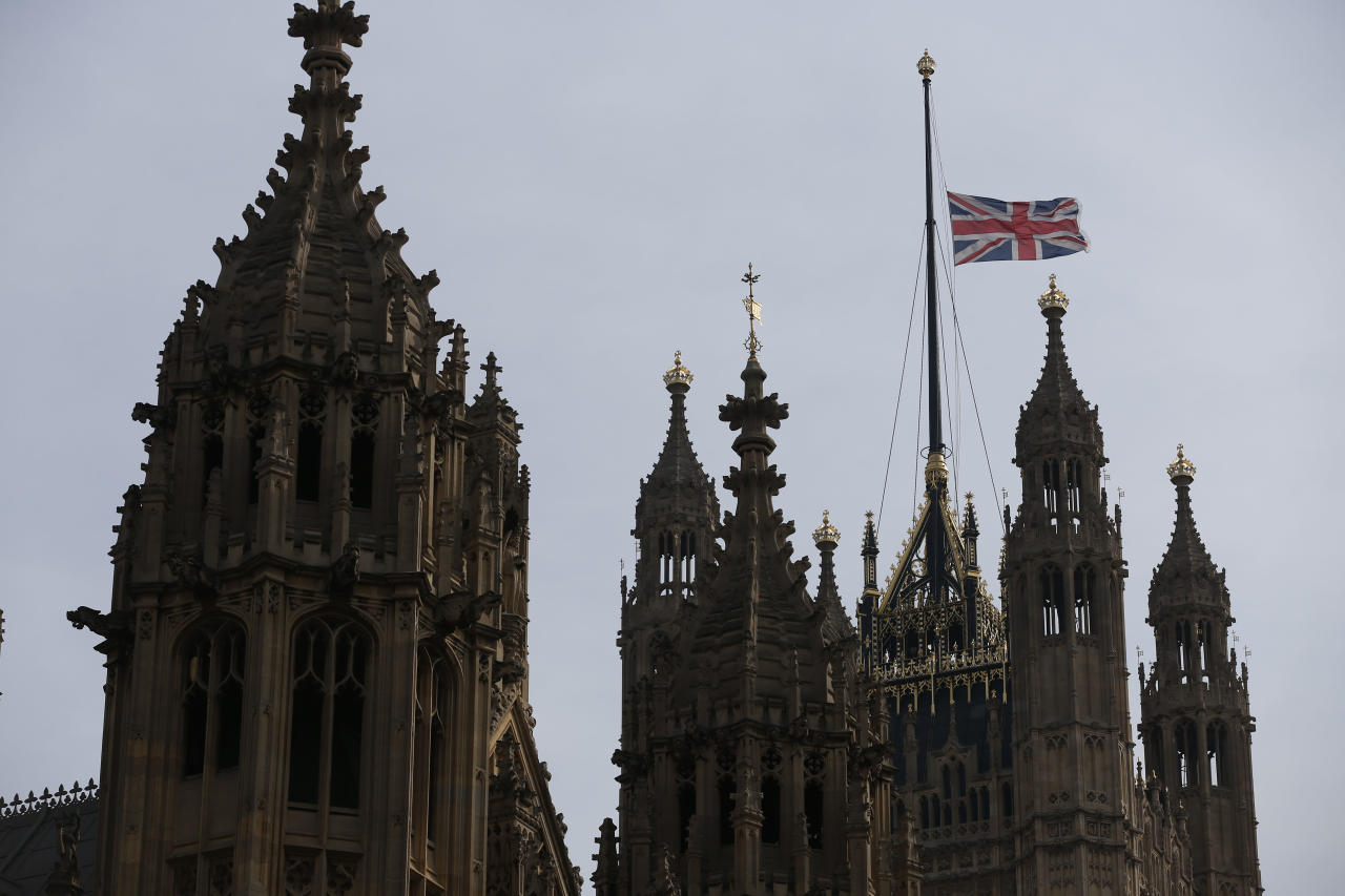 The Union flag flies at half mast at the Houses of Parliament in London, Monday, April 8, 2013, in honour of former British Prime Minister Margaret Thatcher. Thatcher's spokesman, Tim Bell, said the former prime minister died Monday morning of a stroke. Flags were flown at half-staff at Buckingham Palace, Parliament and Downing Street for the 87 year old. Queen Elizabeth II authorized Thatcher to have a ceremonial funeral — a step short of a state funeral — to be held at St. Paul's Cathedral in London with military honors. (AP Photo/Sang Tan)