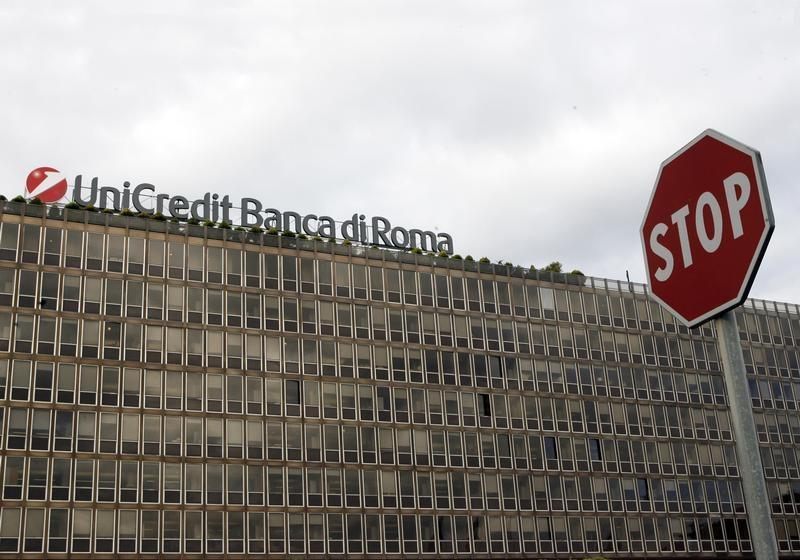 A stop sign is seen in front of the Unicredit building in Rome