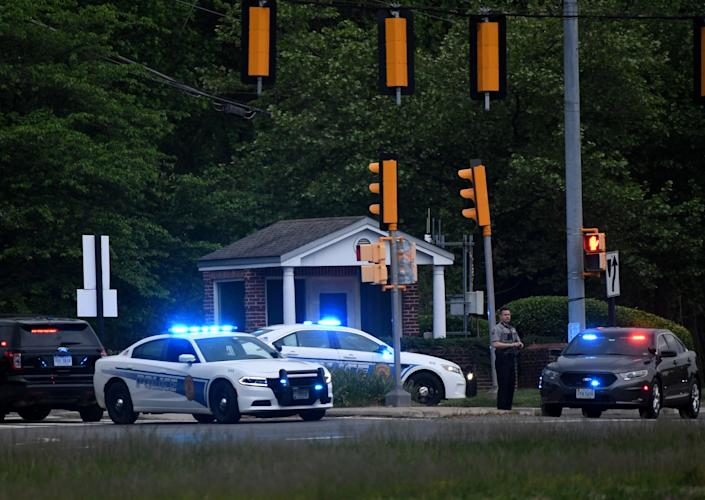 <p>Police cars are seen outside the CIA headquarters's gate after an attempted intrusion earlier in the day in Langley, Virginia, on May 3, 2021</p> (Photo by OLIVIER DOULIERY/AFP via Getty Images)