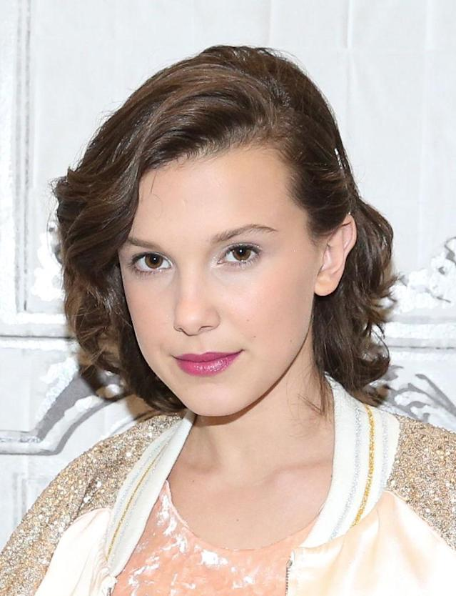 "<p>Don't be so quick to say Millie Bobby Brown looks ""<a href=""https://www.yahoo.com/lifestyle/ok-say-millie-bobby-brown-looks-grown-160305474.html"" data-ylk=""slk:so grown up.;outcm:mb_qualified_link;_E:mb_qualified_link"" class=""link rapid-noclick-resp newsroom-embed-article"">so grown up.</a>"" The 13-year-old actress still appears age-appropriate with her soft brunette curls, silver eyeshadow, and creamy pink lipstick. (Photo: Getty Images) </p>"