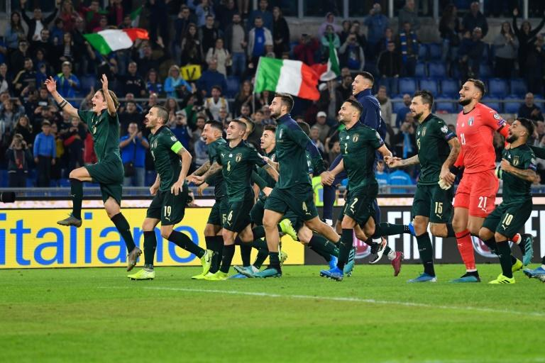 Back among the elite: Italy celebrate after qualifying for Euro 2020 after their World Cup flop. (AFP Photo/Alberto PIZZOLI)
