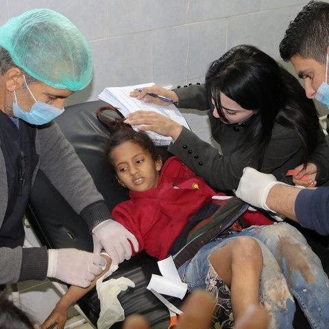 An injured girl receives treatment at the Avrin hospital in the Kurdish-majority town of Afrin in northern Syria - Credit: AFP
