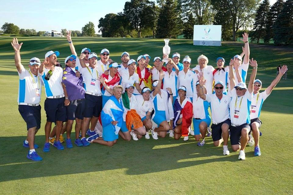 Team Europe poses after they defeated the United States at the Solheim Cup golf tournament (Carlos Osorio/AP) (AP)