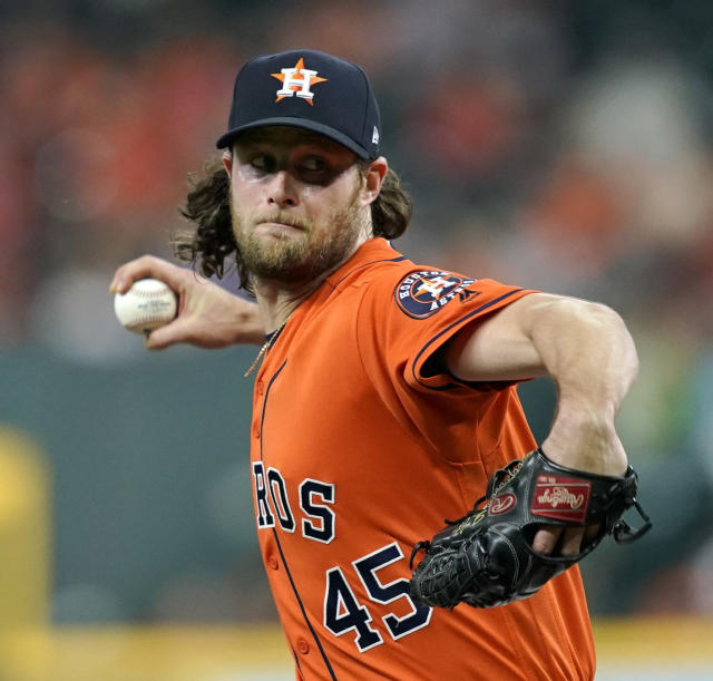 FILE - In this Sept. 21, 2018, file photo, Houston Astros starting pitcher Gerrit Cole throws against the Los Angeles Angels during the first inning of a baseball game in Houston. AL MVP Mookie Betts, NL Cy Young Award winner Jacob deGrom and major league home run champion Khris Davis reached high-priced one-year deals to avoid salary arbitration, while slugger Nolan Arenado and pitchers Cole, Luis Severino and Aaron Nola failed to reach agreements and for now appeared headed to hearings. (AP Photo/David J. Phillip, File)