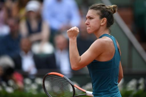 Winning start: Simona Halep shrugged off a terrible first set to see off Alison Riske in her Roland Garros opener