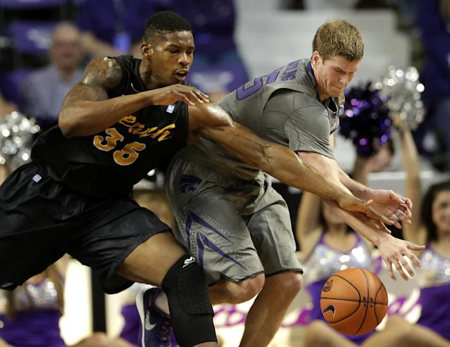 Kansas State's Will Spradling, right, and Long Beach State's Dan Jennings (35) chase a loose ball during the first half of an NCAA college basketball game Sunday, Nov. 17, 2013, in Manhattan, Kan. (AP Photo/Charlie Riedel)
