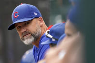 FILE - In this Aug. 12, 2021, file photo, Chicago Cubs manager David Ross watches from the dugout during the eighth inning of a baseball game against the Milwaukee Brewers in Chicago. Ross and president of baseball operations Jed Hoyer have tested positive for COVID-19. (AP Photo/Nam Y. Huh, File)