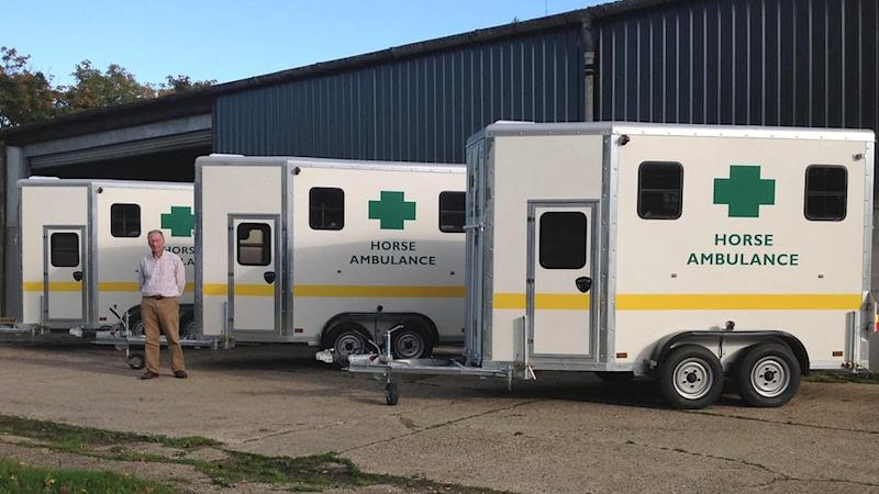 Bill Fellowes of Equisave with three of his horse ambulances